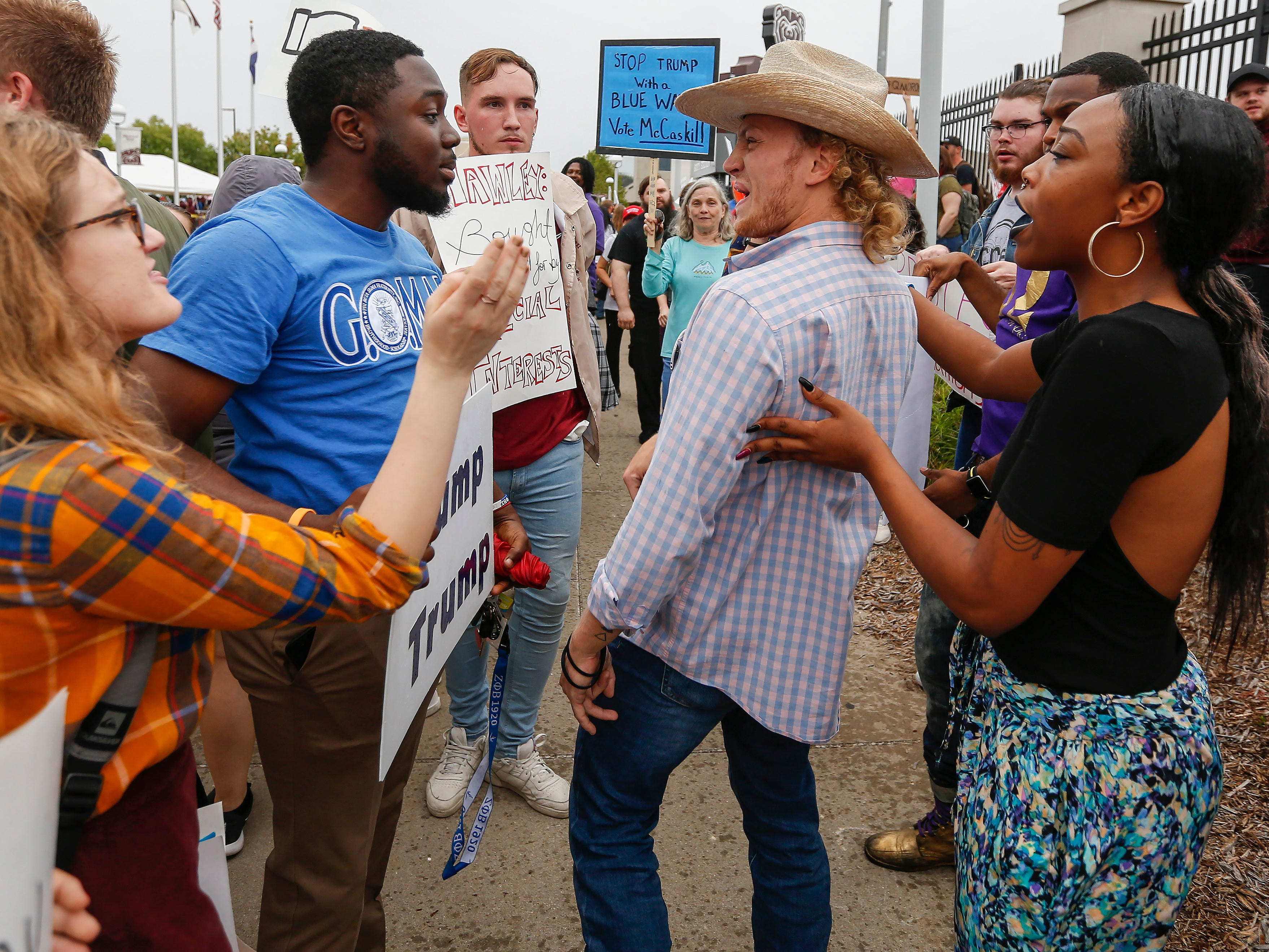 A Trump supporter confronts protesters outside of JQH Arena on the campus of Missouri State University where President Donald Trump was speaking on Friday, Sep. 21, 2018.