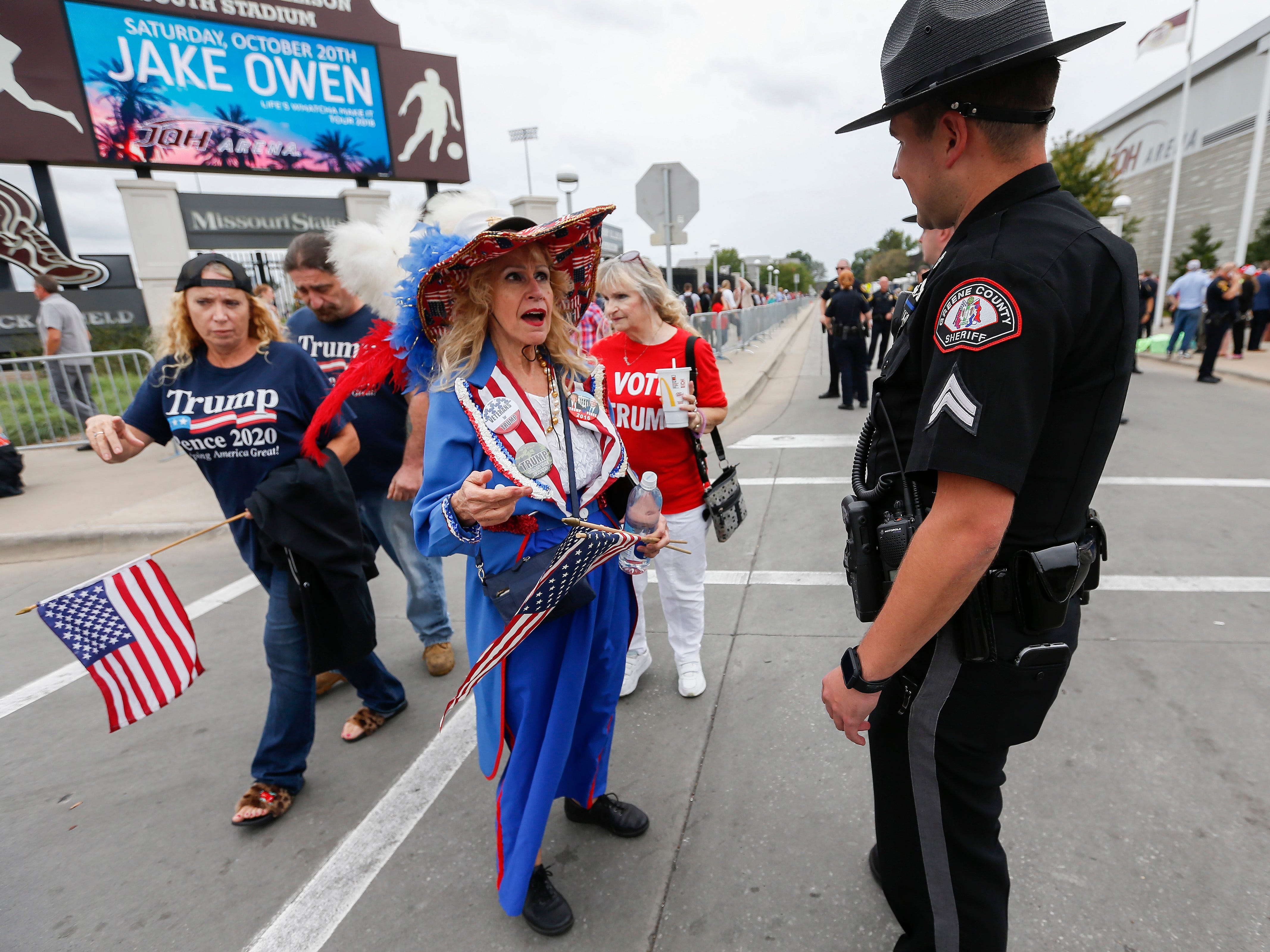 Barbara Ann Nowak talks with a Greene County Sheriff's Deputy outside of JQH Arena on the campus of Missouri State University where President Donald Trump was speaking on Friday, Sep. 21, 2018.