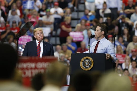 President Trump and Missouri Attorney General Josh Hawley appear at Trump's rally at JQH Arena in Springfield on Friday, Sept. 21, 2018.