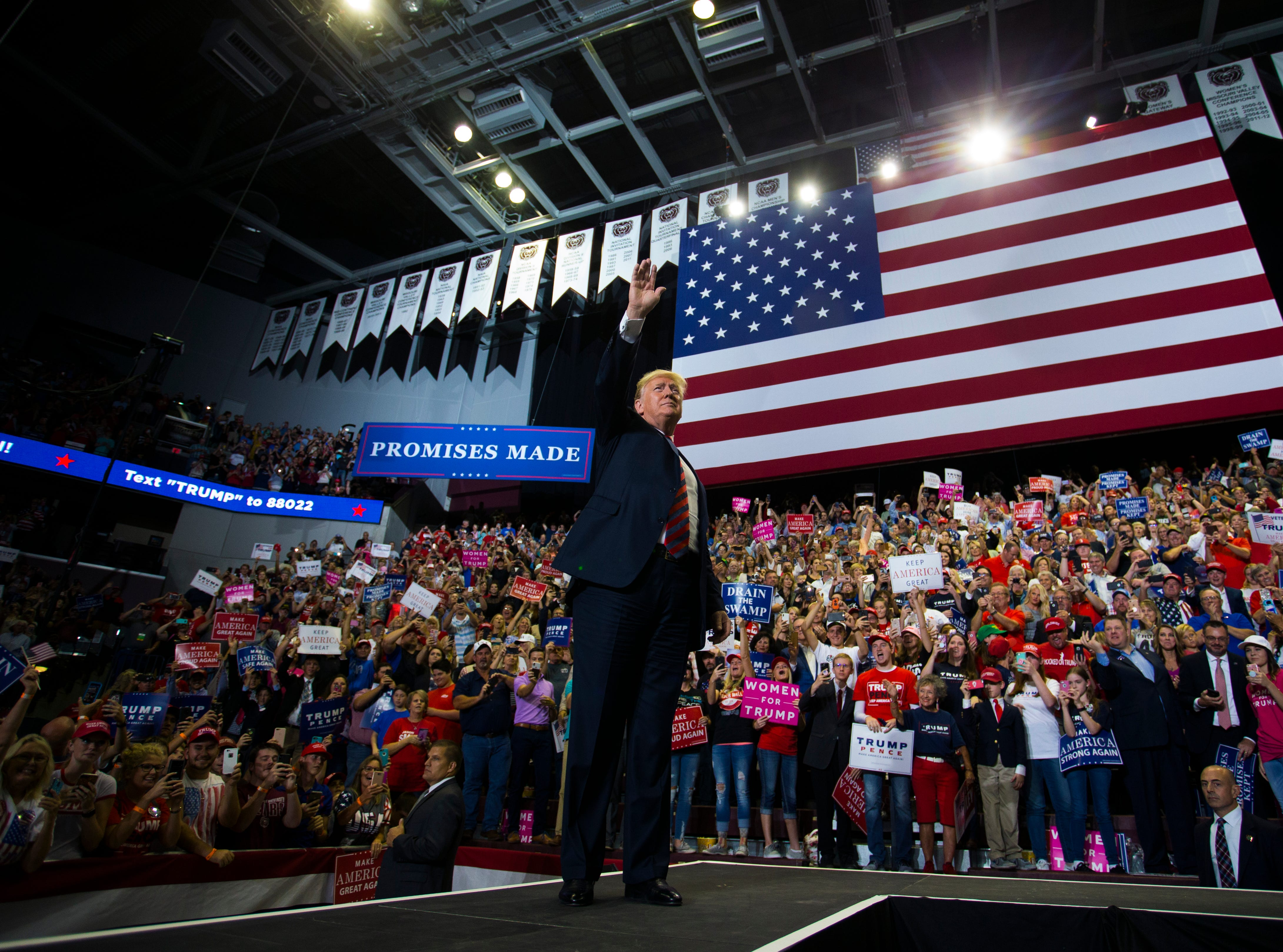 President Donald Trump takes the stage at a rally at JQH Arena in Springfield on Friday, Sept. 21, 2018