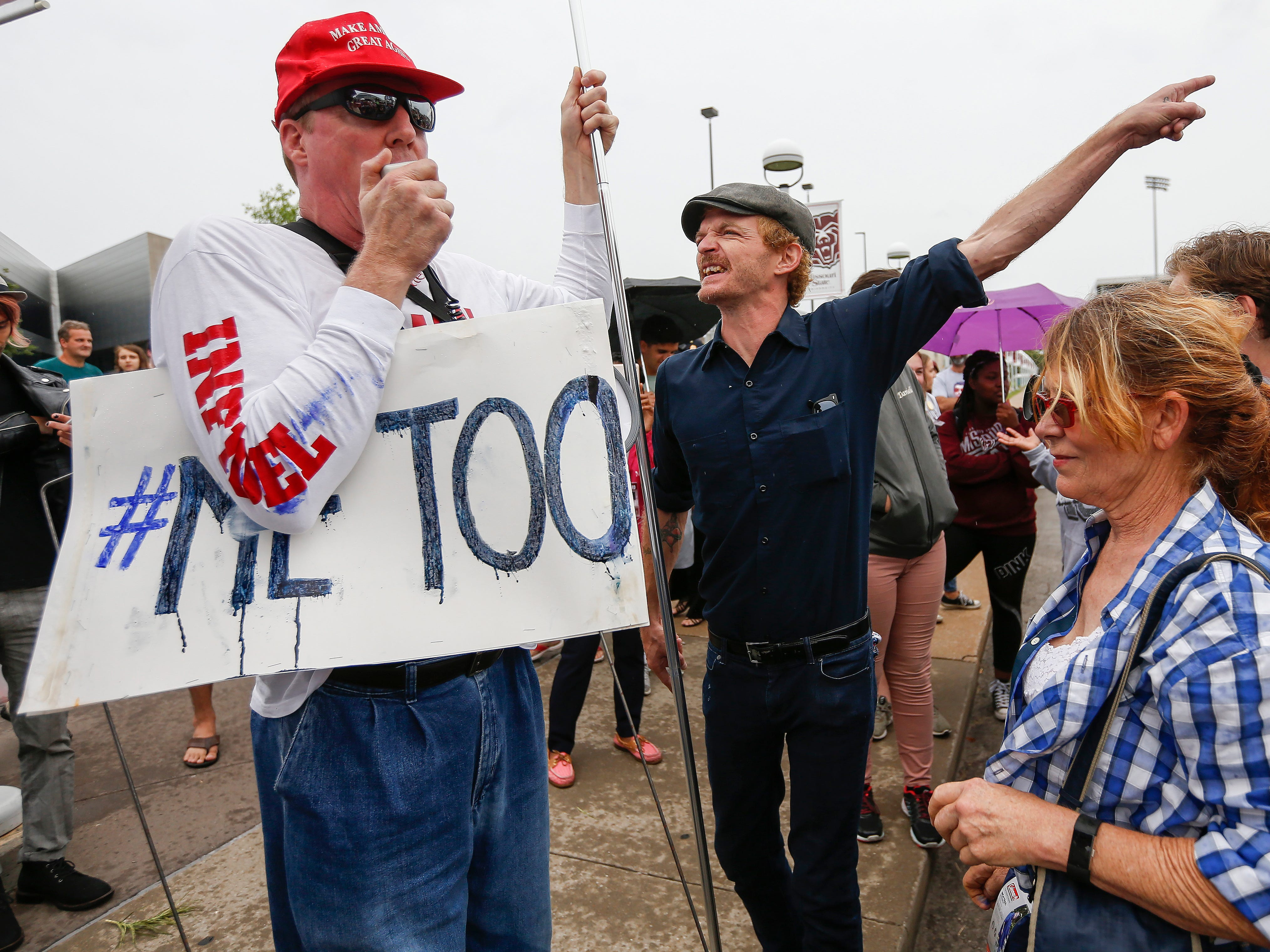 Protesters confront a vocal Trump supporter outside of JQH Arena on the campus of Missouri State University where President Donald Trump was speaking on Friday, Sep. 21, 2018.
