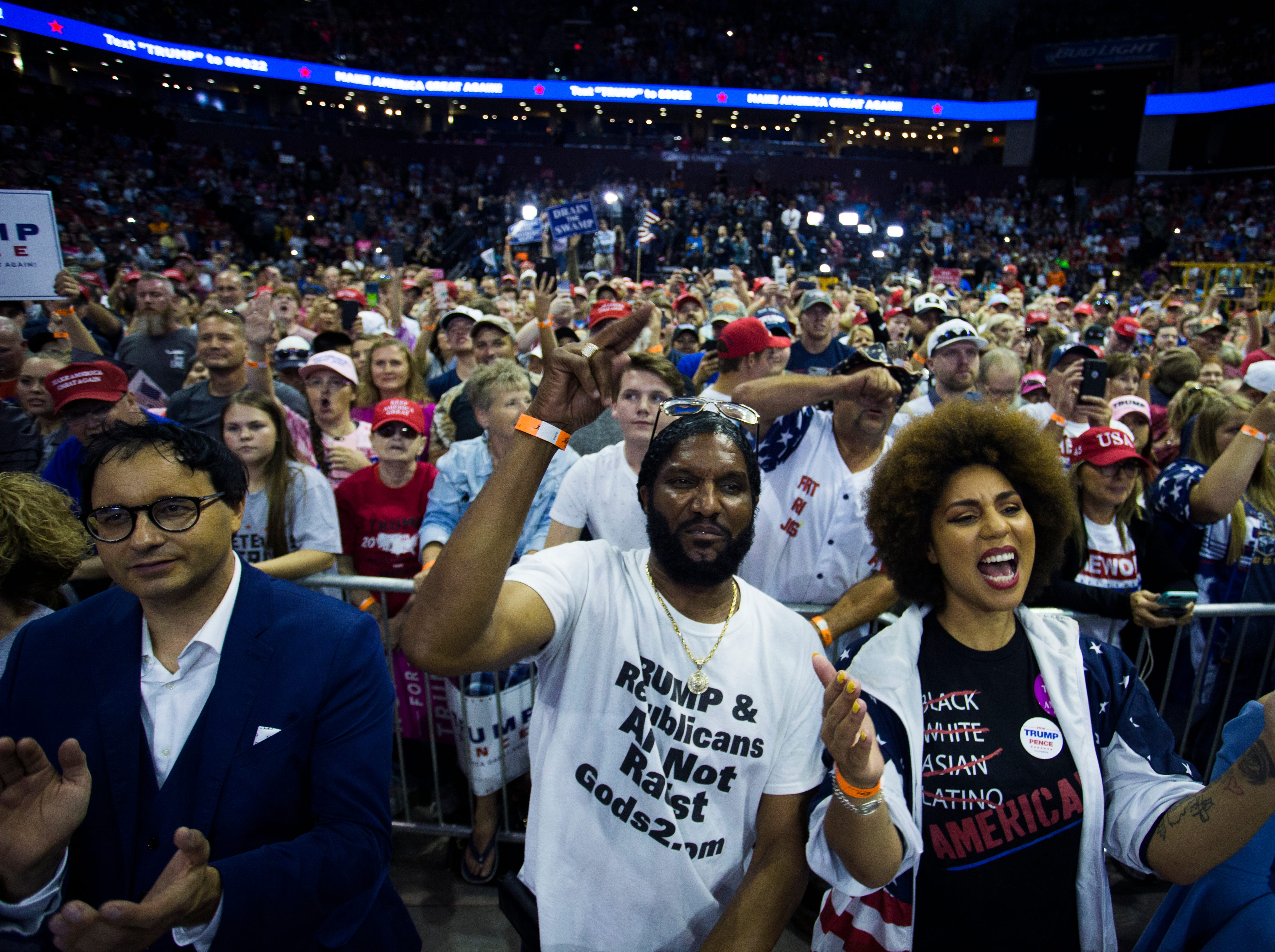 Supporters of Donald Trump cheer him on during a rally at JQH Arena in Springfield on Friday, Sept. 21, 2018