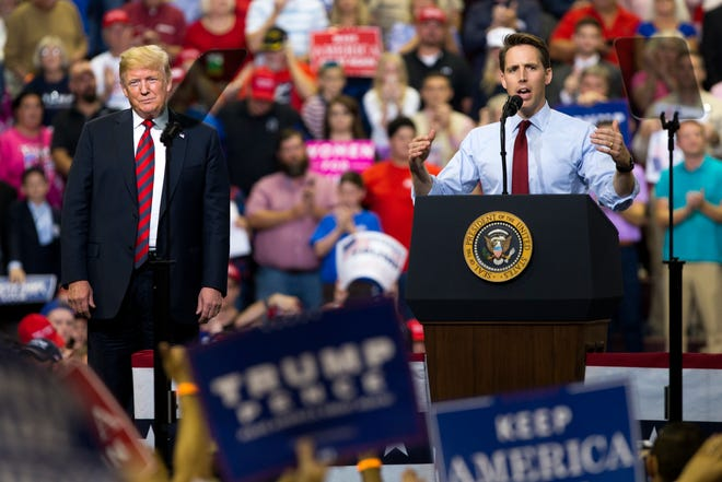 President Trump and Missouri Attorney General Josh Hawley appear at a rally at JQH Arena in Springfield on Friday, Sept. 21, 2018.