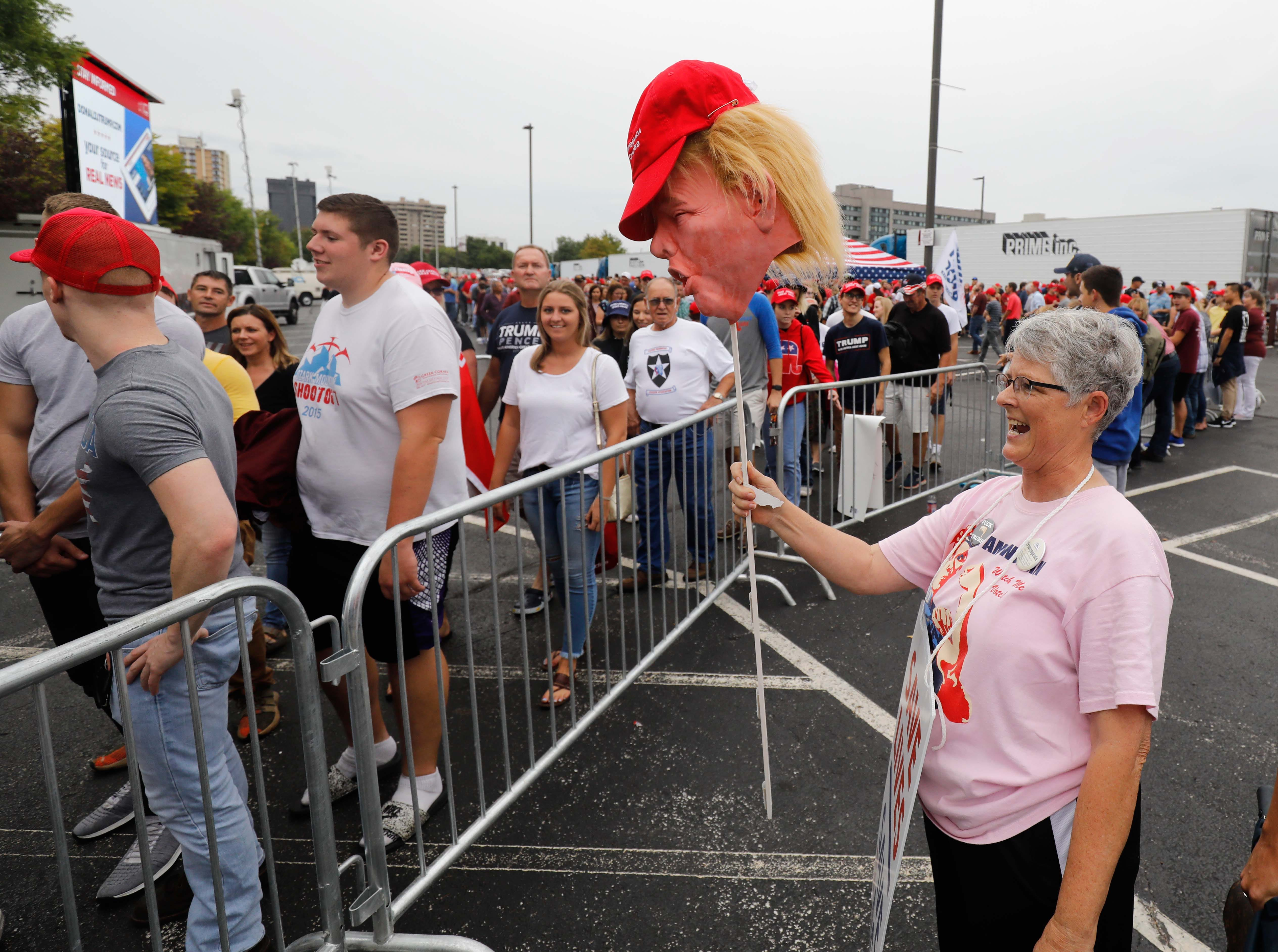 President Donald Trump was greeted by thousands of supporters and several hundred protesters.