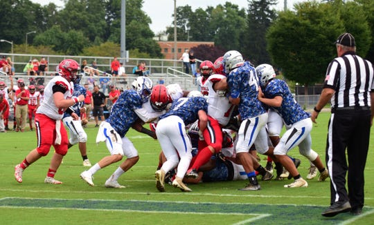Robert E. Lee's defense stops Stonewall Jackson fullback Udreka Claude at the goal line in the first half of their Shenandoah District football game on Saturday, Sept. 22, 2018, at Winston Wine Memorial Stadium in Staunton, Va.