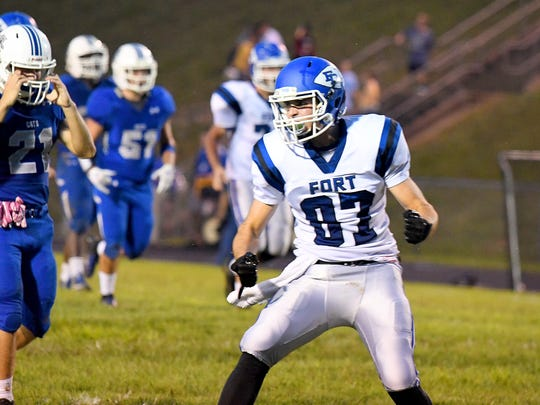 Fort Defiance's Bryce Owens takes a moment to celebrate after coming away with a pass completion and first down during a football game played in Lexington on Friday, Sept. 21, 2018.