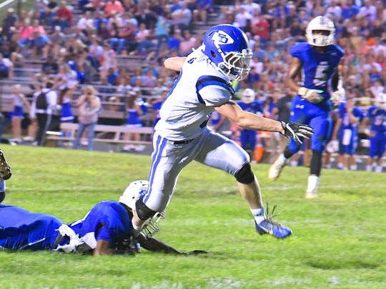 Fort Defiance's Matthew Wonderley has the ball as he breaks free of a tackle and keeps running for the end zone during a football game played in Lexington on Friday, Sept. 21, 2018.