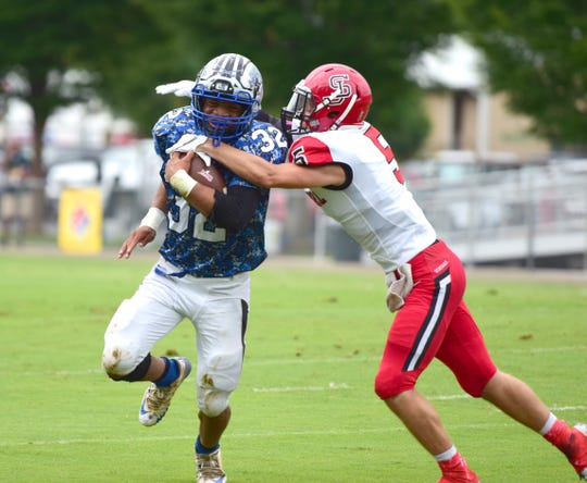 Robert E. Lee's Bam Dobbins fights off a tackle attempt by Stonewall Jackson's Logan Ritchie in the first half of their Shenandoah District football game on Saturday, Sept. 22, 2018, at Winston Wine Memorial Stadium in Staunton, Va.