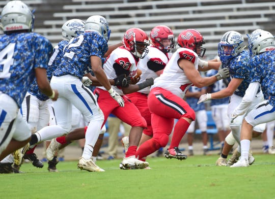 Robert E. Lee's defense closes in on Stonewall Jackson fullback Udreka Claude in the first half of their Shenandoah District football game on Saturday, Sept. 22, 2018, at Winston Wine Memorial Stadium in Staunton, Va.