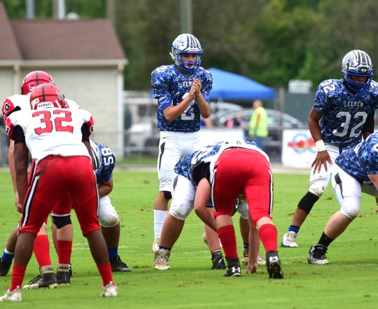 Robert E. Lee quarterback Will Dod calls a play during the first half of the Leemen's Shenandoah District football game against Stonewall Jackson on Saturday, Sept. 22, 2018, at Winston Wine Memorial Stadium in Staunton, Va.
