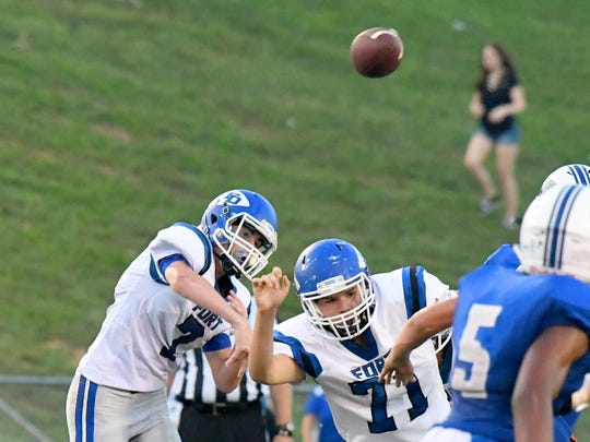 Fort Defiance quarterback Austin Monroe fires off a pass downfield, overtop teammate Alexander Correa during a football game played in Lexington on Friday, Sept. 21, 2018.