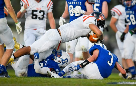 Tech's Isaiah Green dives across the line for the two point conversion after a touchdown against Sartell during the first half Friday, Sept. 21, at Sartell.