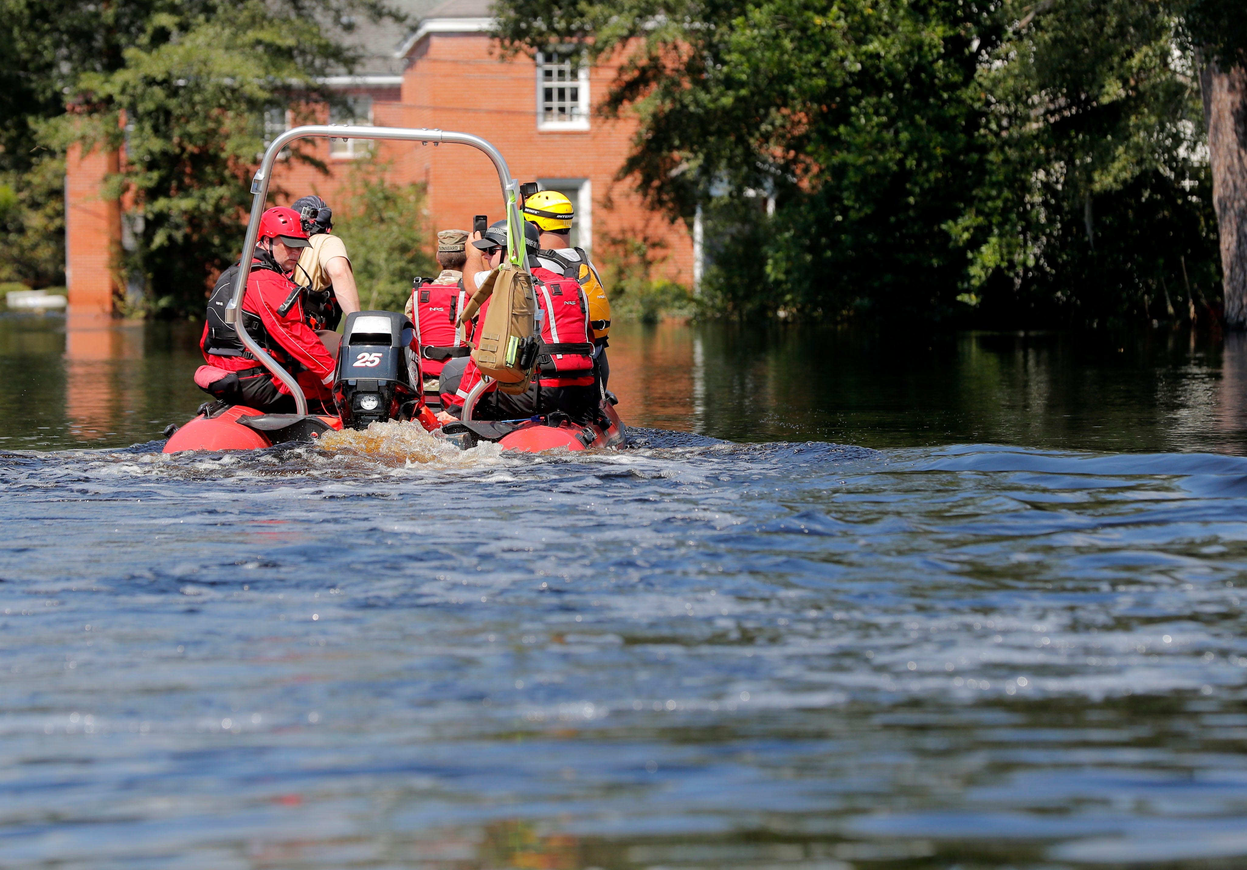 A swift recuse boat motors through floodwaters in the aftermath of Hurricane Florence in Nichols, S.C., Friday, Sept. 21, 2018. Virtually the entire town is flooded and inaccessible except by boat, just two years after it was flooded by Hurricane Matthew.