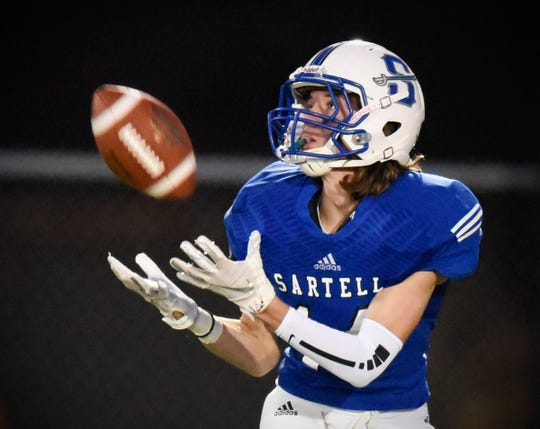 Sartell's Dominic Hagy pulls in a long pass and takes it in to score against Tech during the first half Friday, Sept. 21, at Sartell.