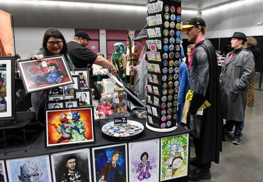 Convention-goers talk with vendors at LionCon on Saturday at the River's Edge Convention Center.