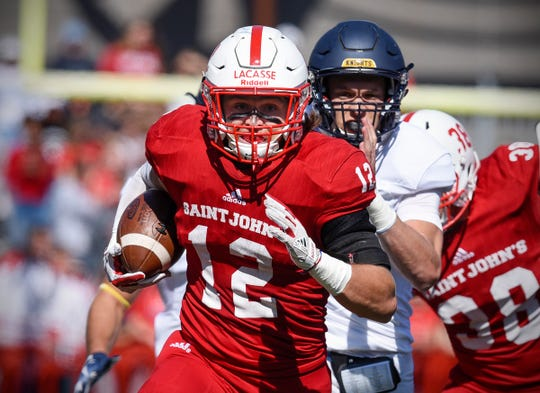 St. John's safety Ryan LaCasse runs with an interception against Carleton in the first half Saturday, Sept. 22, in Collegeville.