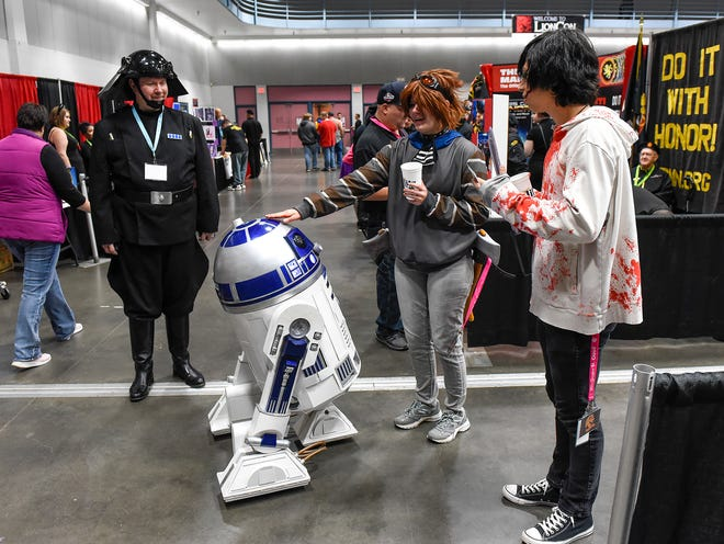 Imperial Navy Trooper Robert Schubert, of Rochester, got some love for the robotic R2-D2 he built and maneuvered through the crowd at LionCon on Saturday at the River's Edge Convention Center.
