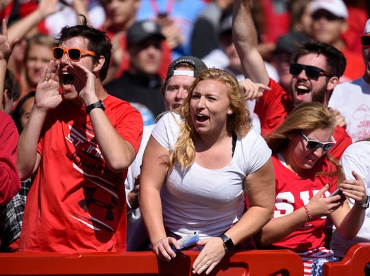 St. John's fans celebrate a touchdown against Carleton in the first half Saturday, Sept. 22, in Collegeville.