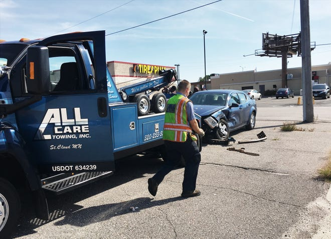 A car crashed into the corner of 33rd Avenue North and Division Street, by PepperJax Grill on the afternoon of Saturday, Sept. 22, 2018. Emergency responders were able to get the car away from the accident site fairly quickly. Damage was limited to landscaping, road signage and front of car.
