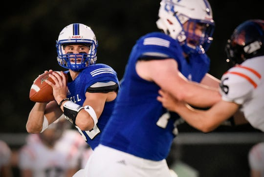 Sartell quarterback Ryan Giguere drops back to throw against Tech  during the first half Friday, Sept. 21, at Sartell.