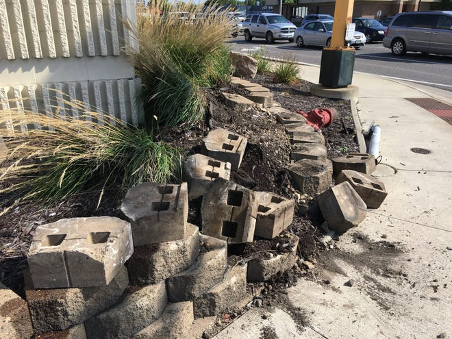 A car crashed into the corner of 33rd Avenue North and Division Street, by PepperJax Grill on the afternoon of Saturday, Sept. 22, 2018. Damage was limited to landscaping, road signage and front of car.