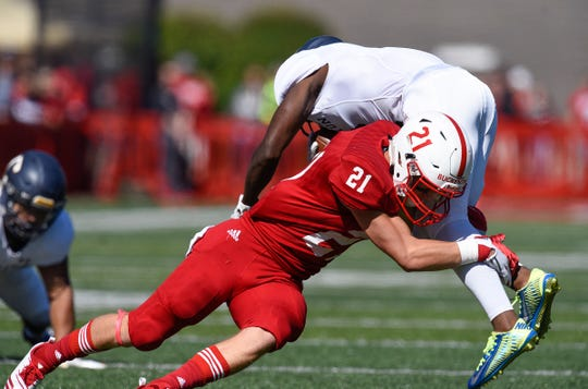 St. John's linebacker Brady Buckentine tackles Carleton's Emanual Williams on a carry in the first half Saturday, Sept. 22, in Collegeville.