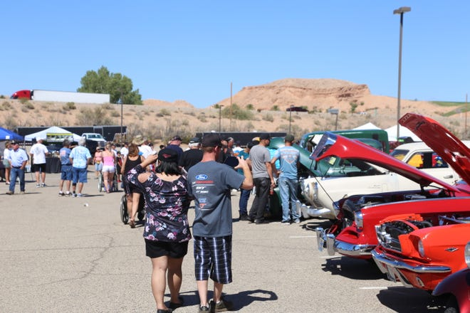 Spectators check out the cars at the Mesquite Super Run on Sept. 21, 2018.