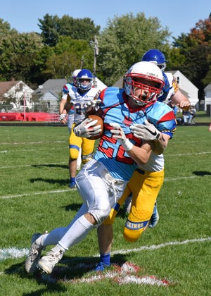 Newman Catholic's Kasey Kalafice heads up field during the Cardinals win over Gibraltar on Saturday afternoon. Kalafice rushed for five touchdowns and returned an interception for another score in the game.