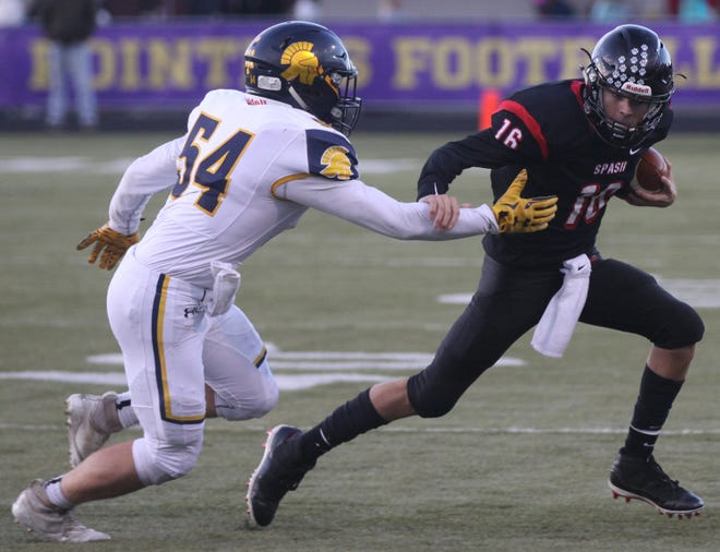 SPASH quarterback Brett Ehr, right, takes the ball past Wausau West's Mason Schlegel during the high school football game Friday, Sept. 21, 2018, in Stevens Point. SPASH won 21-0.
