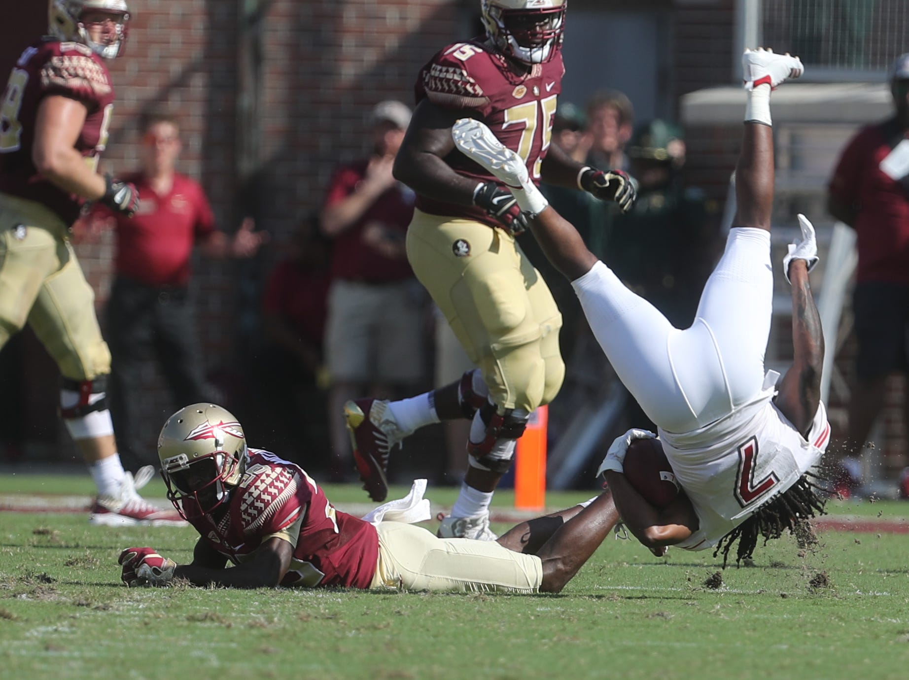 Northern Illinois Huskies cornerback Tifonte Hunt (7) flips after taking a hit from a Seminole during a game between the Florida State University Seminoles and the Northern Illinois University Huskies at Doak S. Campbell Stadium in Tallahassee, Fla. Saturday, September 22, 2018.