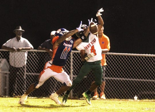 Jefferson County's Da'Shon Davis makes a pass breakup against FAMU DRS receiver Montadius Moore, preserving the Tigers' 25-22 win over the Rattlers.
