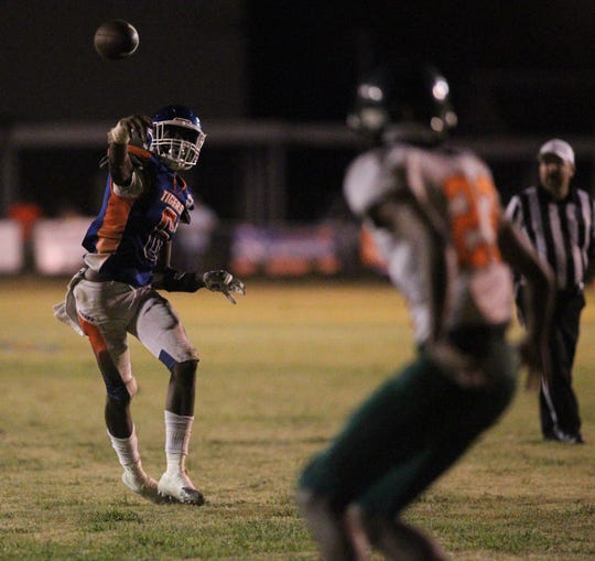 Jefferson County quarterback Javion Patrick throws a fourth-quarter touchdown pass while rolling out as the Tigers beat FAMU DRS 25-22 on Friday night.