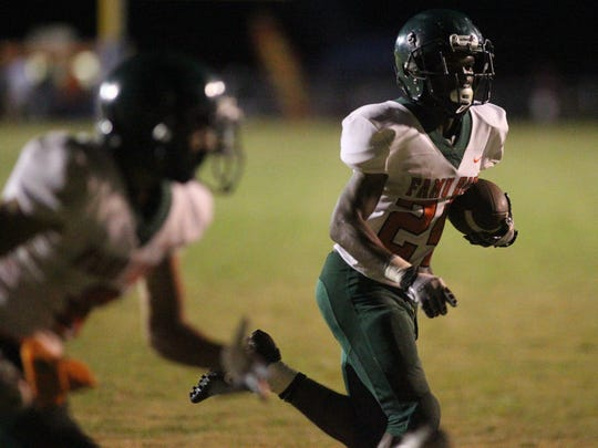 FAMU DRS running back Maurice Kirksey takes off on a 6-yard touchdown run. Kirksey ran for 158 yards and two TD in the Rattlers' 25-22 loss to Jefferson County.