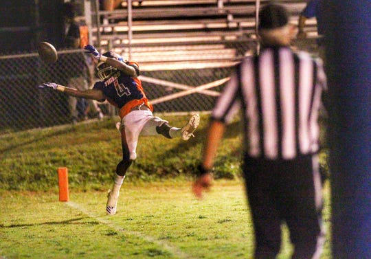 Jefferson County's Jacquez Hughes tries to haul in a touchdown pass, but it was just over him during the Tigers' 25-22 win over FAMU DRS.