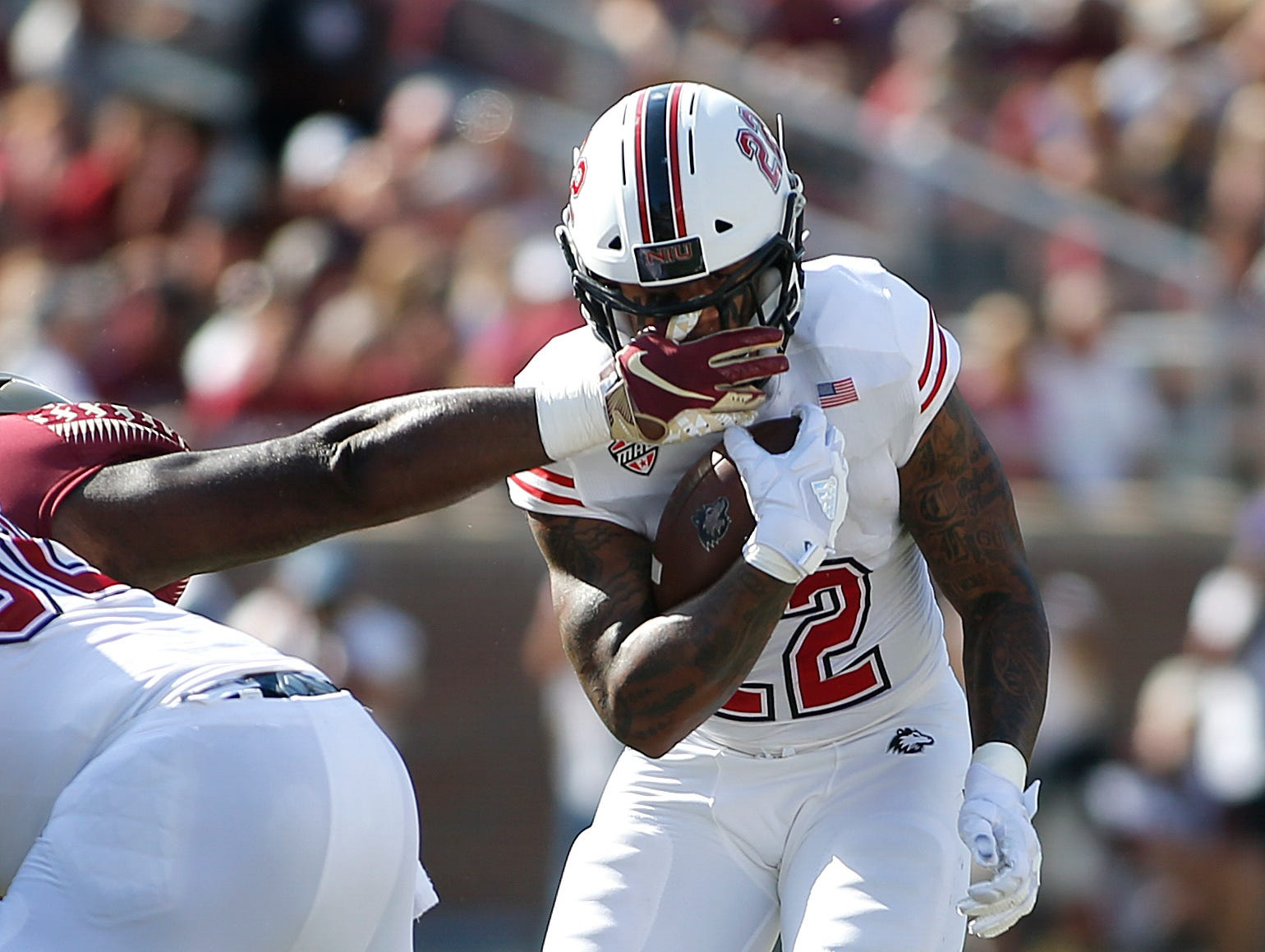 Sep 22, 2018; Tallahassee, FL, USA; Northern Illinois Huskies running back Tre Harbison (22) takes a hand to the face during the second quarter of play at Doak Campbell Stadium.