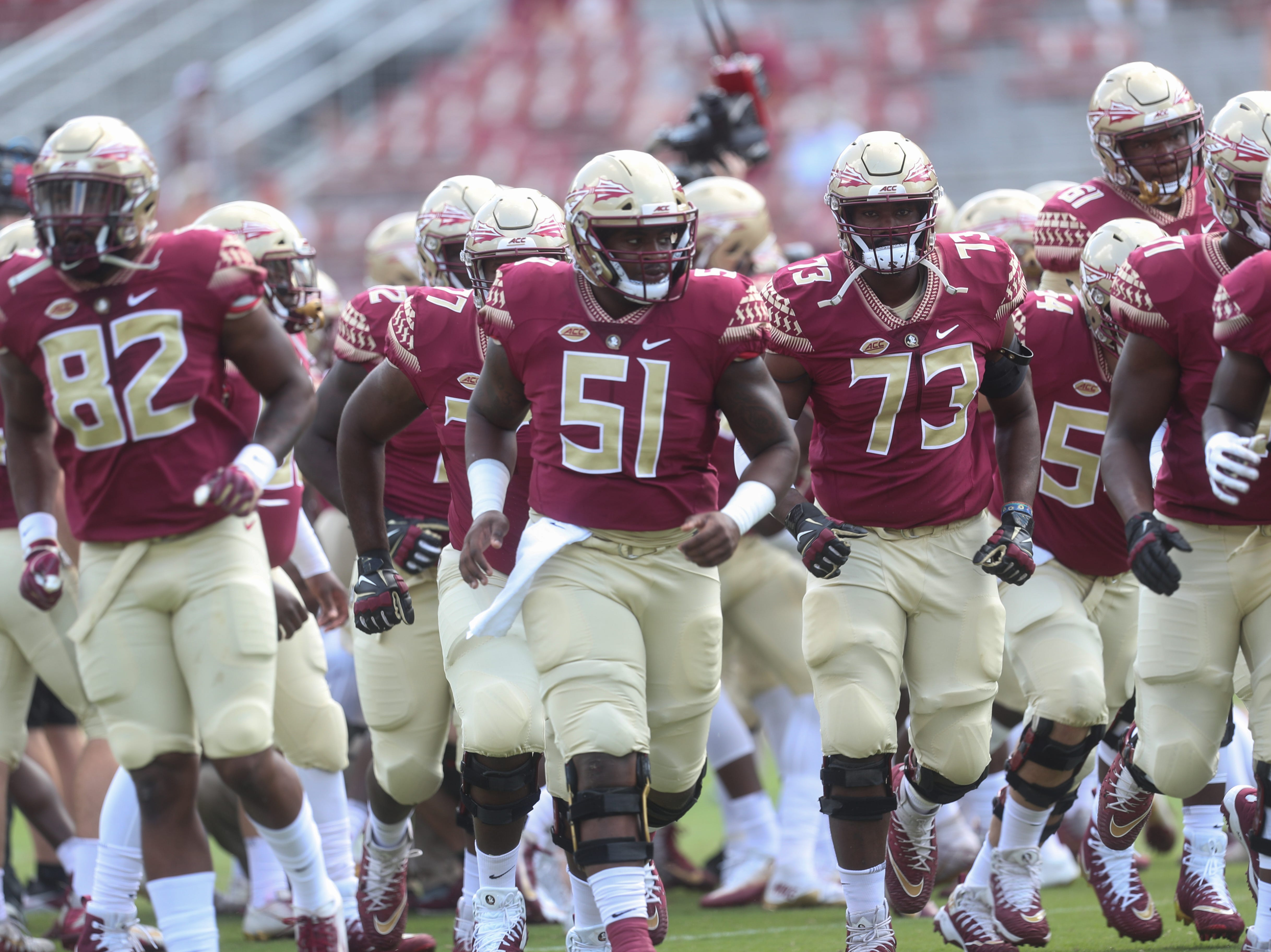 The FSU Seminoles take the field before a game between the Florida State University Seminoles and the Northern Illinois University Huskies at Doak S. Campbell Stadium in Tallahassee, Fla. Saturday, September 22, 2018.