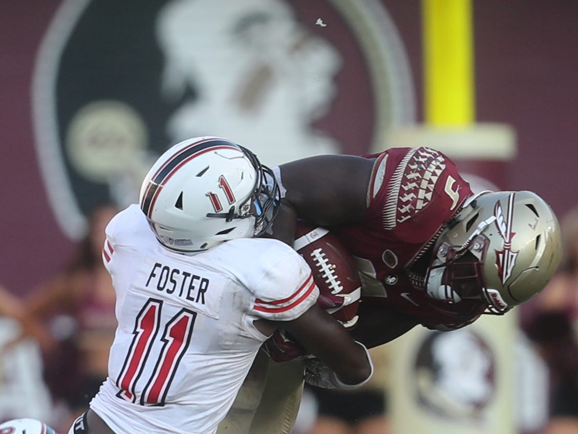 Northern Illinois Huskies safety Trayshon Foster (11) brings down Florida State Seminoles running back Jacques Patrick (9) during a game between the Florida State University Seminoles and the Northern Illinois University Huskies at Doak S. Campbell Stadium in Tallahassee, Fla. Saturday, September 22, 2018.