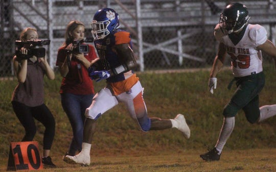 Jefferson County receiver Da'Shon Davis speeds to the end zone ahead of FAMU DRS linebacker Jalen Randolph for a 24-yard touchdown during the Tigers' 25-22 win.