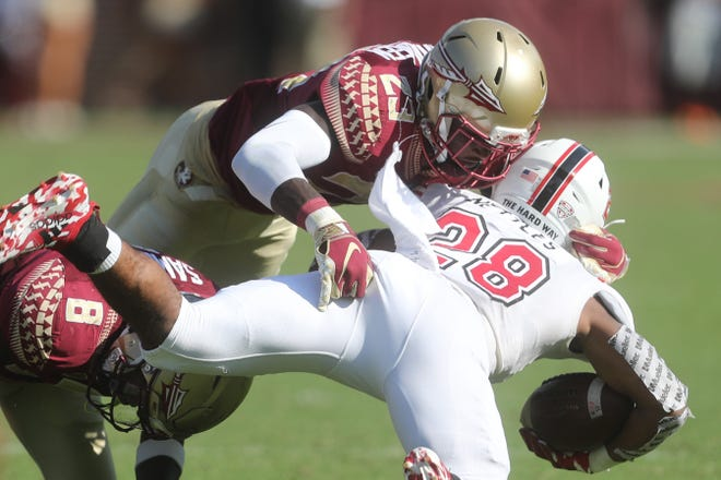 Florida State Seminoles defensive back Hamsah Nasirildeen (23) tackles Northern Illinois Huskies running back Jordan Nettles (28) during a game between the Florida State University Seminoles and the Northern Illinois University Huskies at Doak S. Campbell Stadium in Tallahassee, Fla. Saturday, September 22, 2018.