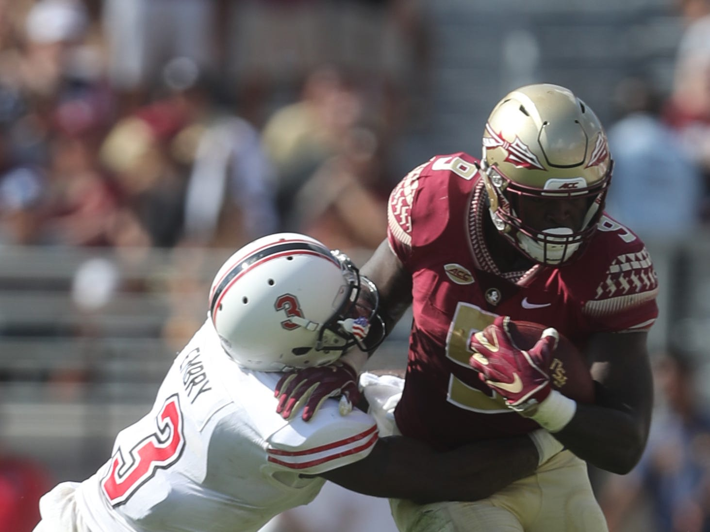 Northern Illinois Huskies cornerback Jalen Embry (3) tackles Florida State Seminoles running back Jacques Patrick (9) during a game between the Florida State University Seminoles and the Northern Illinois University Huskies at Doak S. Campbell Stadium in Tallahassee, Fla. Saturday, September 22, 2018.