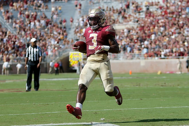 Sep 22, 2018; Tallahassee, FL, USA; Florida State Seminoles running back Cam Akers (3) scores a touchdown against the  Northern Illinois Huskies during the second quarter of play at Doak Campbell Stadium.