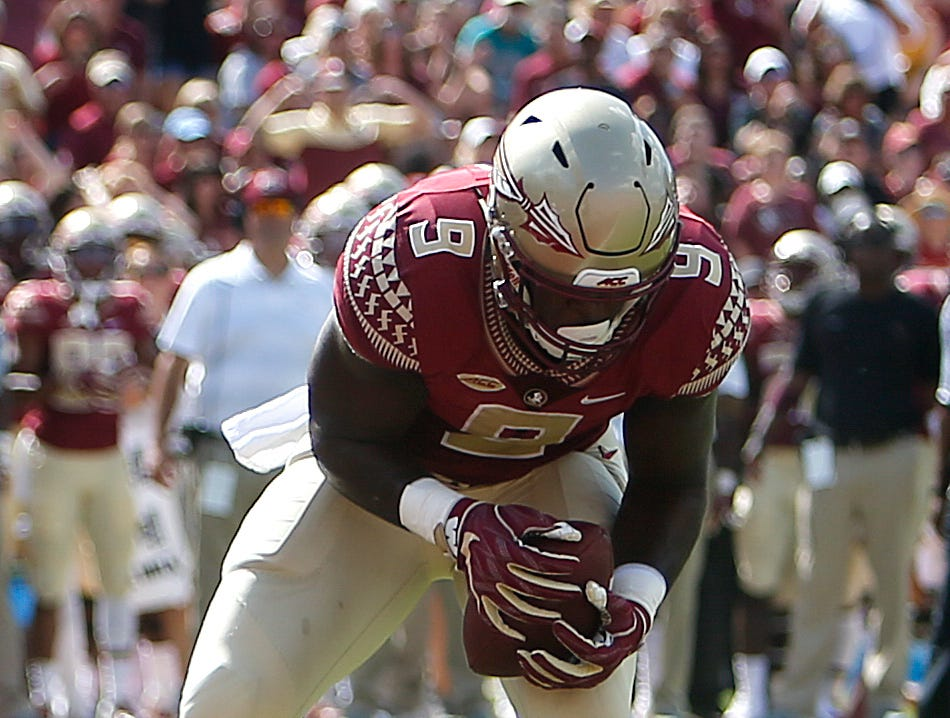 Sep 22, 2018; Tallahassee, FL, USA; Florida State Seminoles running back Jacques Patrick (9) catches a deflected ball for a touchdown during the first quarter of play at Doak Campbell Stadium.