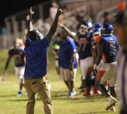 Jefferson County head coach Leroy Smith celebrates as the Tigers beat FAMU DRS in a high school football game on Friday, Sept. 21, 2018. The host Tigers won 25-22.