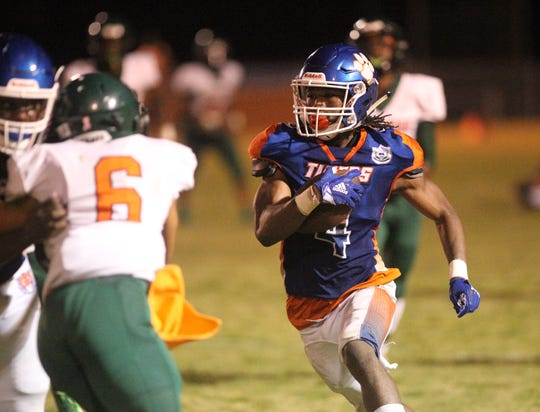 Jefferson County's Jacquez Hughes takes off on a long punt return against FAMU DRS. Hughes returned a punt 80 yards for a touchdown in the first quarter of the Tigers' 25-22 win.