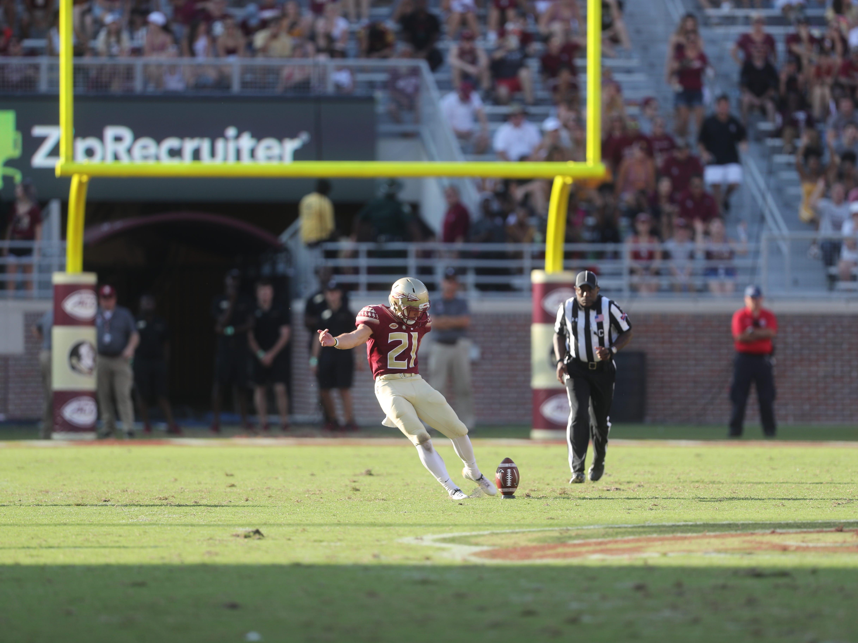 Florida State Seminoles punter Logan Tyler (21) kicks during a game between the Florida State University Seminoles and the Northern Illinois University Huskies at Doak S. Campbell Stadium in Tallahassee, Fla. Saturday, September 22, 2018.