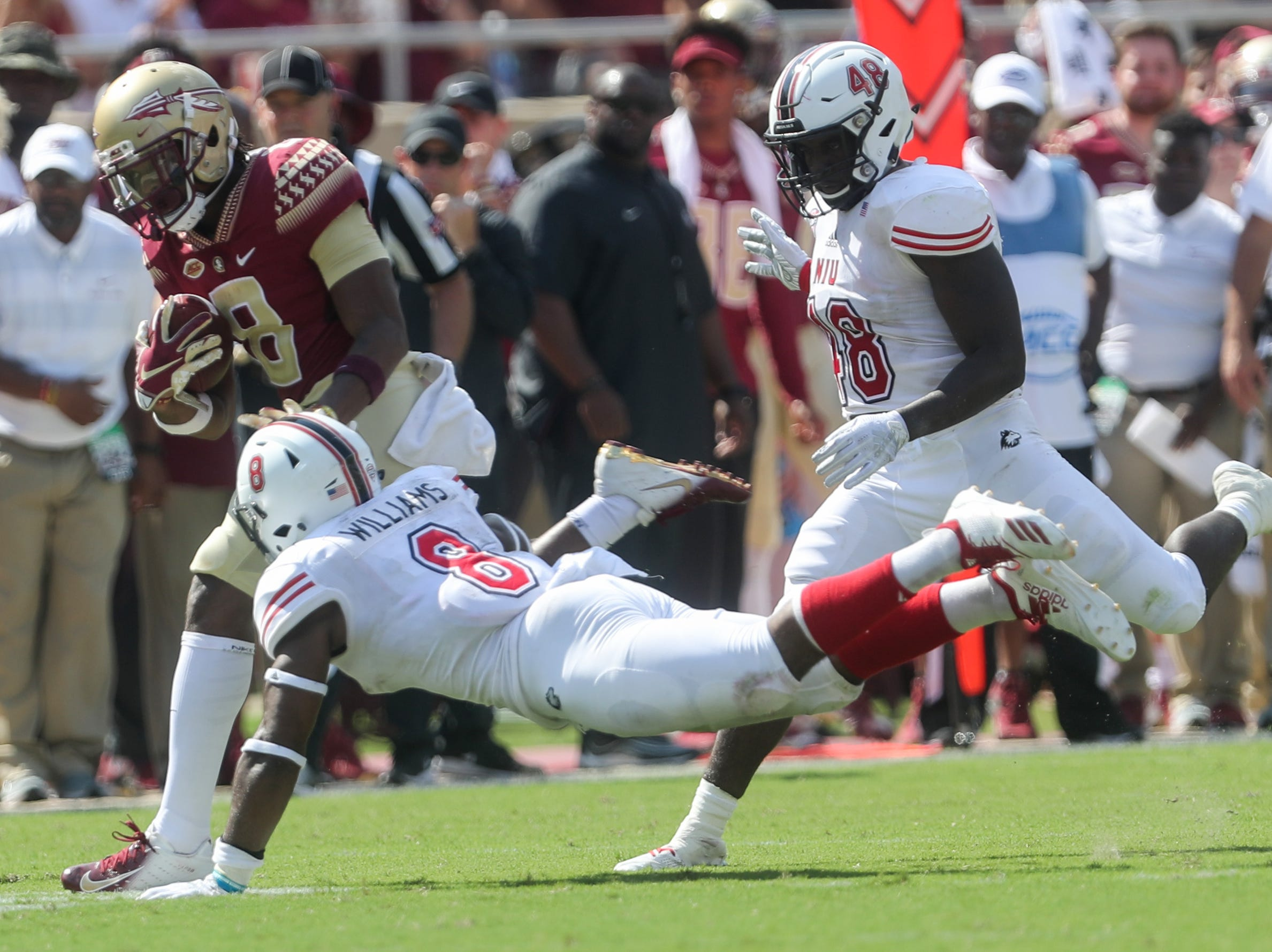 Florida State Seminoles wide receiver Nyqwan Murray (8) gets tackled by Northern Illinois Huskies safety Mykelti Williams (8) during a game between the Florida State University Seminoles and the Northern Illinois University Huskies at Doak S. Campbell Stadium in Tallahassee, Fla. Saturday, September 22, 2018.