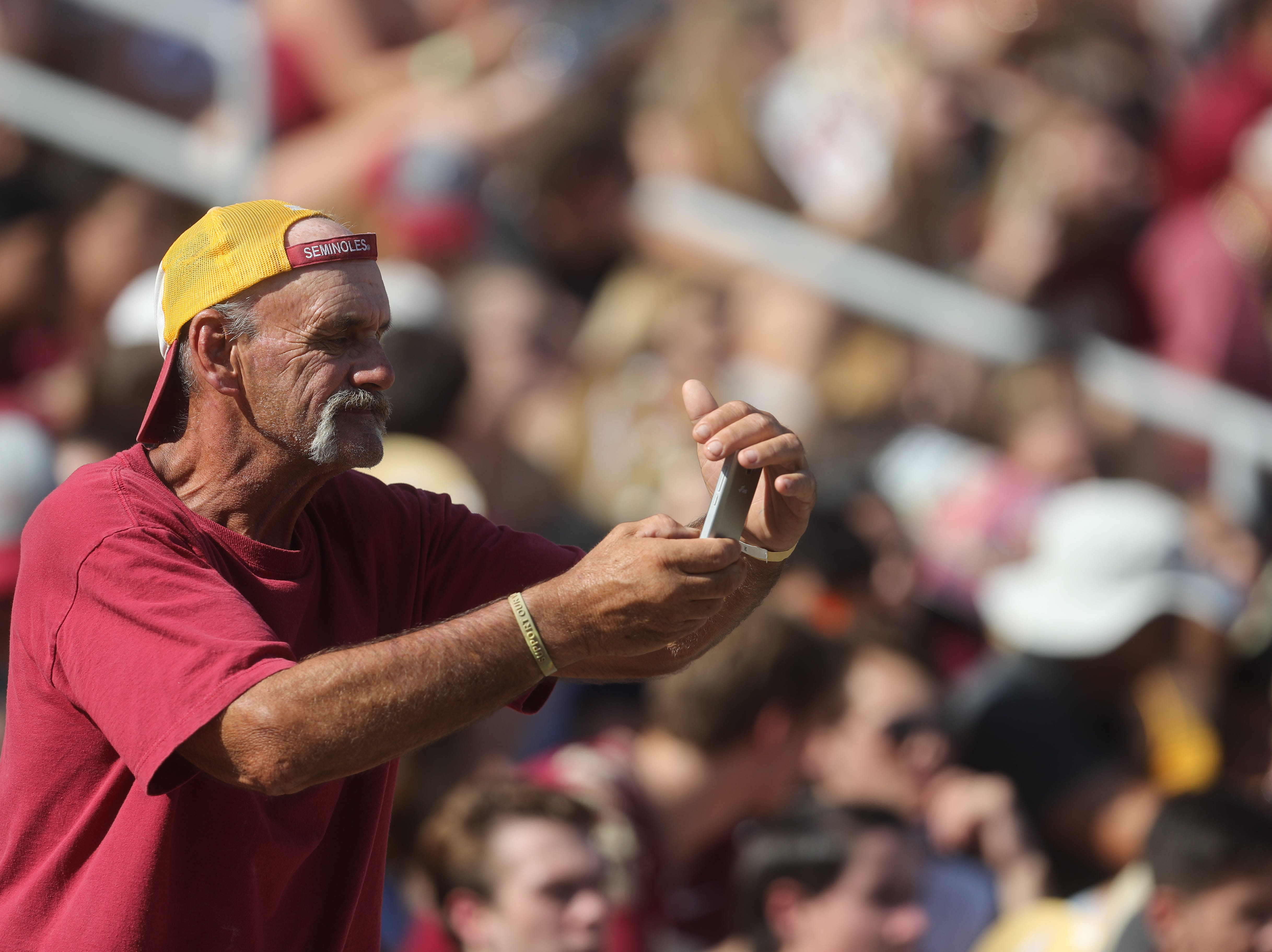 A fan takes a photo during a game between the Florida State University Seminoles and the Northern Illinois University Huskies at Doak S. Campbell Stadium in Tallahassee, Fla. Saturday, September 22, 2018.