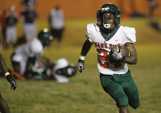 FAMU DRS running back Maurice Kirksey takes off on a 24-yard touchdown run. Kirksey ran for 158 yards and two TD in the Rattlers' 25-22 loss to Jefferson County.
