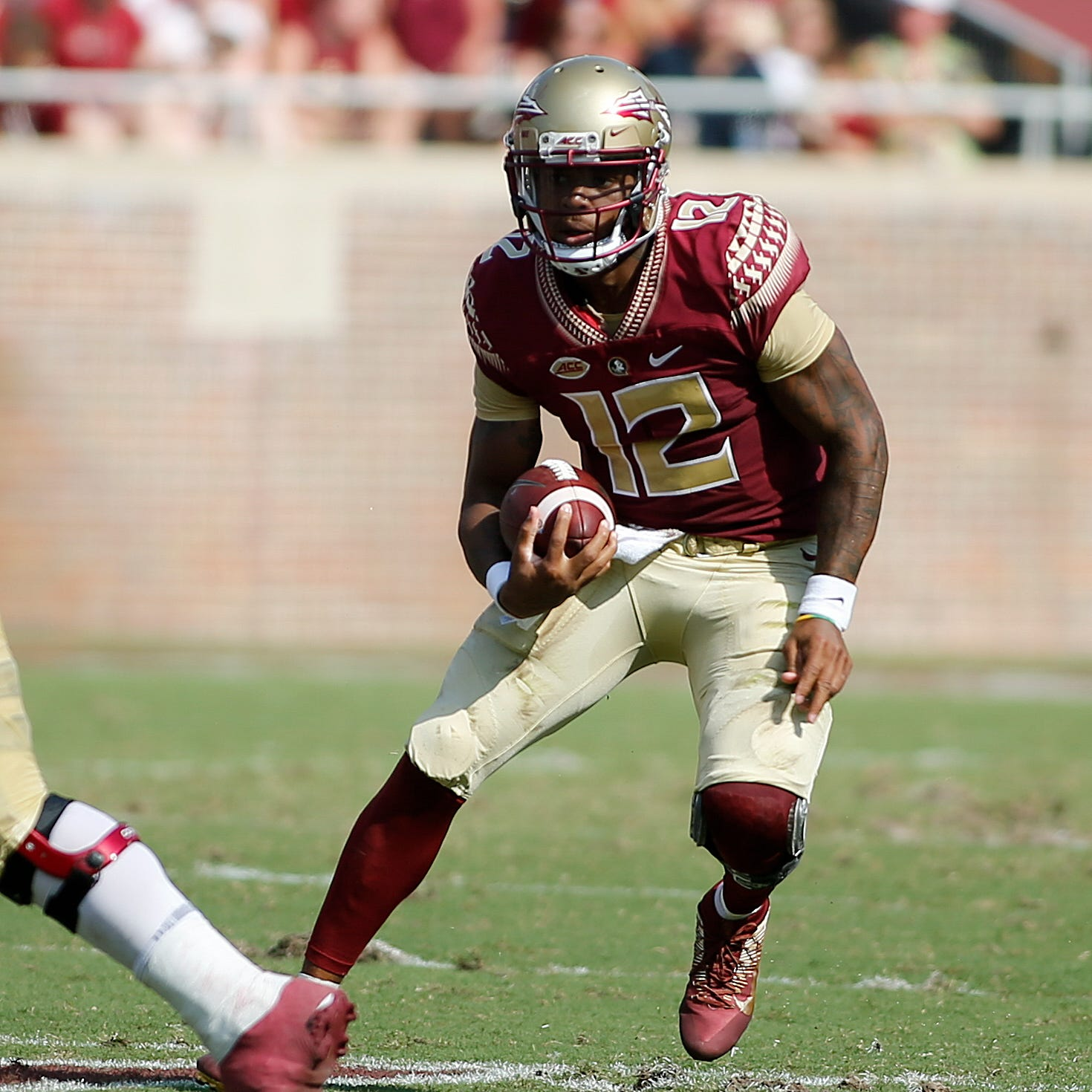 Sep 22, 2018; Tallahassee, FL, USA;  Florida State Seminoles quarterback Deondre Francois (12) runs during the first quarter of play at Doak Campbell Stadium.