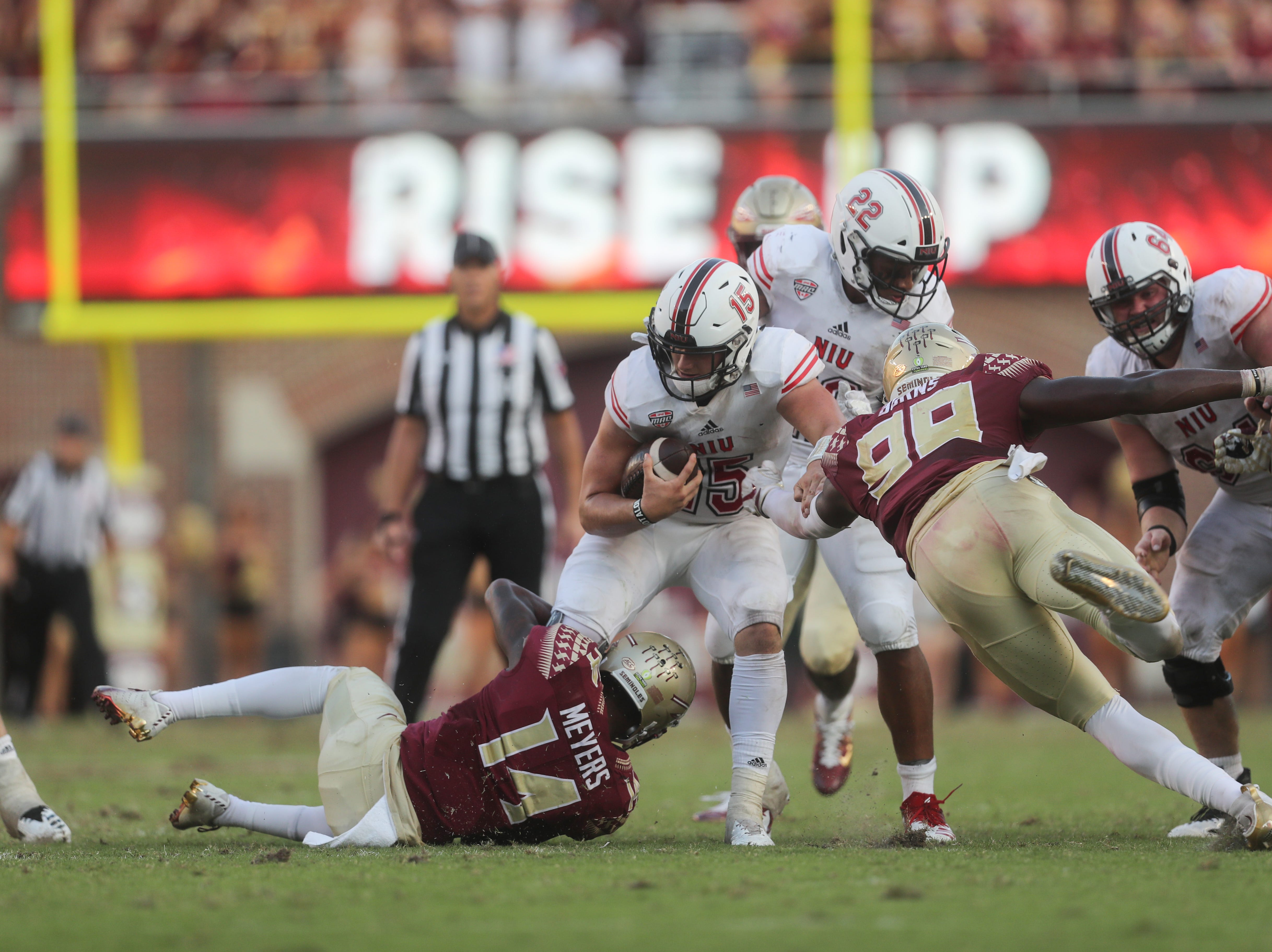 Northern Illinois Huskies quarterback Marcus Childers (15) is surrounded by Seminoles during a game between the Florida State University Seminoles and the Northern Illinois University Huskies at Doak S. Campbell Stadium in Tallahassee, Fla. Saturday, September 22, 2018.